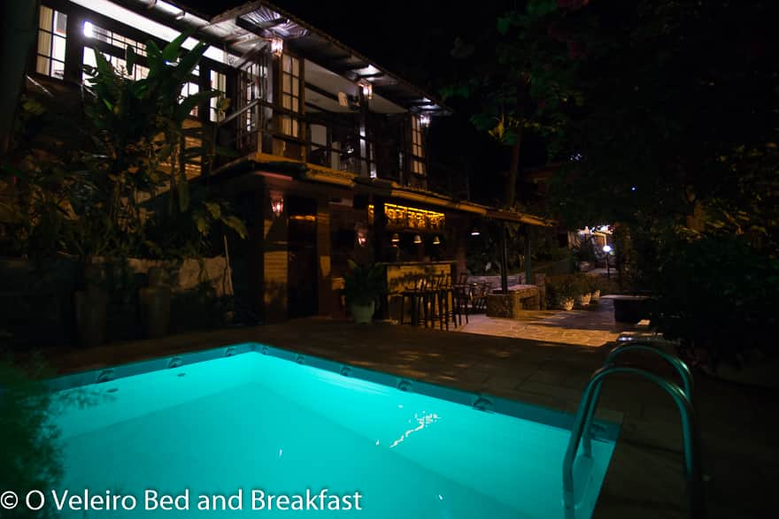 Night view of pool and bar area