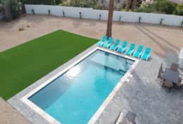 Brand new pool with baja ledge and lounge chairs