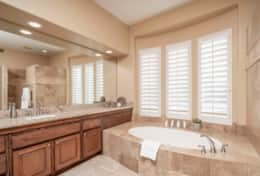 Master Bathroom with large jetted tip and multiple vanities