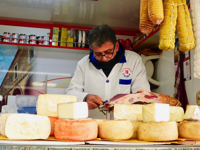 Selling local cheese at a market in Umbria