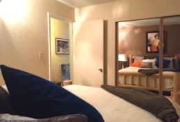 downstairs master bedroom mirrored closets, very comfortable bed