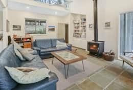 Cosy fire in the lounge - The River House Gipsy Point - Good House Holiday Rentals