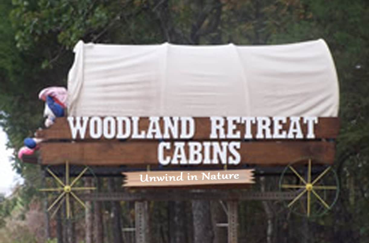 Woodland Retreat Cabins - sign