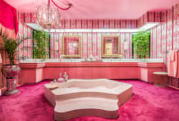 The pink theme continues through to the bathroom