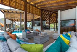 Massive open air living area with souring custom ceiling and wood work.
