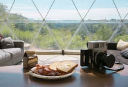 Asheville Glamping- Dome interior - breakfast with a view
