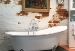 Bathroom with clawfoot bathtub and shower