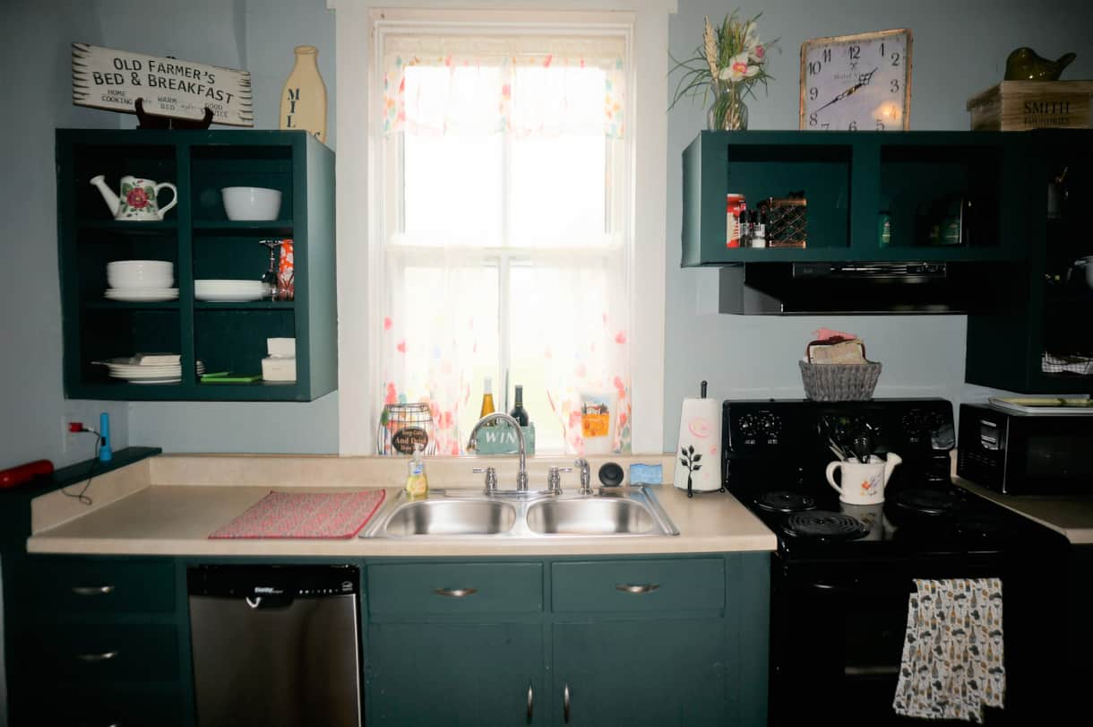 Great kitchen with cooking supplies, dishes, and the coffee bar is fully stocked.
