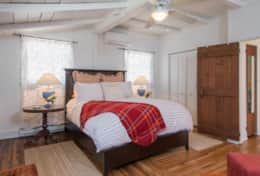 Master bedroom with high, queen size bed