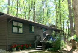 This sweet retreat is in a lovely wooded setting