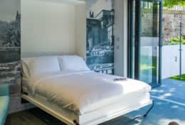 Lie in bed with the bi-folding doors open