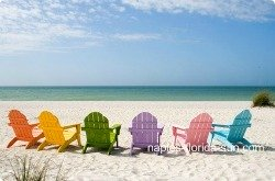 colored chairs on beach, naples beach, beach chairs, naples florida, naples weather