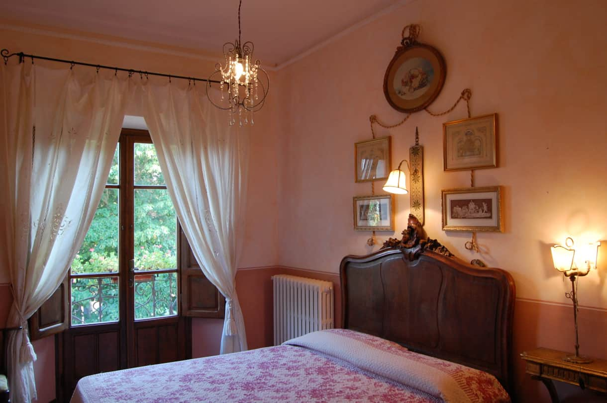 Bedroom 2 of this Tuscan villa with a pretty Romeo balcony and a good built-in wardrobe.