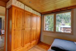 Two double-door wardrobes in the bedroom provide ample storage space