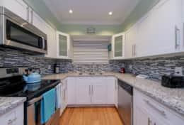 Fully remodeled kitchen with granite counter tops and stainless steel appliances.