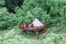 The Deluxe Bell tent #2 at Asheville Glamping sits on its own deck with it's own private hot tub