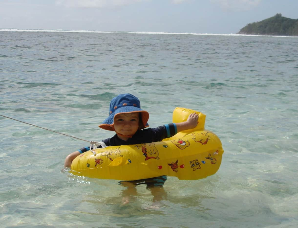 Children of all ages love the calm waters of Anse Forbans