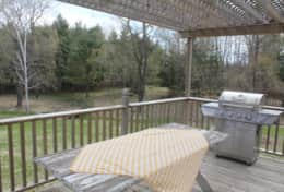 Large deck with table and BBQ