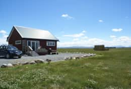 Highlands Eco Panel House with Darma Hut in background