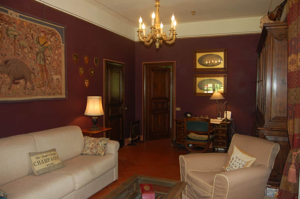 The cosy study with antique furnishings and a sofa bed with orthopaedic mattress in this villa.
